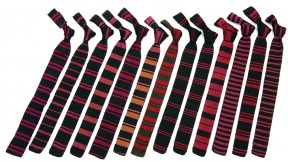 Neckties distinguished athletes in 14 major sports, with a generic tie for all minor sports, says Renny Little, curator (pro bono) of the Lee Family Hall of Athletic History. Here (from left) are those for football, soccer, cross country, track and field, ice hockey, swimming, basketball, wrestling, lacrosse, baseball, lightweight crew, golf, and minor sports. Missing are those for heavyweight crew and squash.