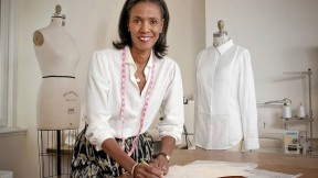 Designer Katiti Kirondé with her white shirts at the Fashion Lab of Fisher College in Boston