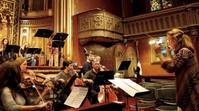 Sara Jobin conducts a rehearsal of <i>Purchase of Manhattan,</i> which premiered at the Marble Collegiate Church in November.