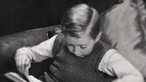 Photo of a young boy reading a book