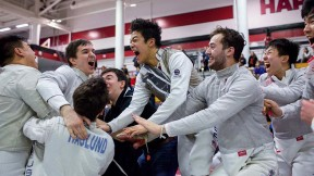 fencers celebrate a championship win