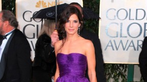 Sandra Bullock arrives at the 2010 Golden Globe Awards in a violet Bottega Veneta gown.