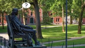 Photograph of John Harvard statue, Harvard Yard, with cartoon balloon question mark, about uncertainties surrounding the fall semester