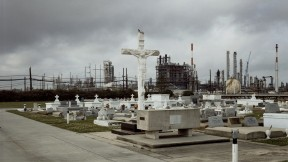 Old and new along the Mississippi: Holy Rosary Cemetery and Dow Chemical Corporation, Taft, Louisiana, 1998. From <i>Petrochemical America</i>