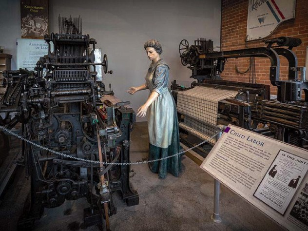 Statue of a woman working in a textile mill