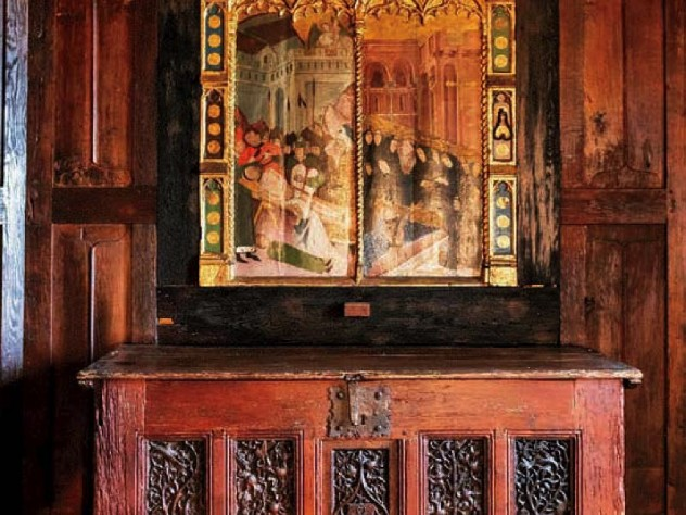 Dining room with antique chest and fifteenth-century religious painting or a martyrdom