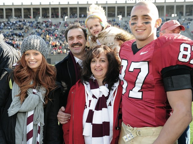Saturday's hero: Marco Iannuzzi and his family before The Game. Left to right, his wife, Jenn, his parents, Tony and Cathy, and his two-year-old daughter, Isla.