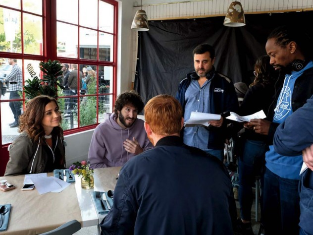 "Schaffer works on a scene with star Dave Burd (second from left) and other cast members from ""Dave."""