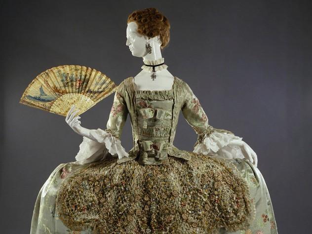 Ornate eighteenth-century dress with wide hooped skirt