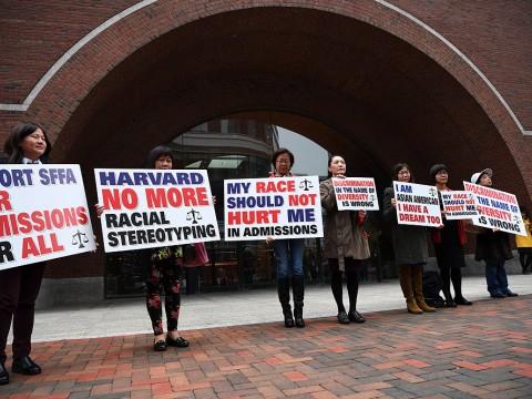 "hotograph of demonstrators in front of the federal courthouse in Boston where the SFFA v. Harvard trial took place, with signs reading ""Harvard No More Racial Stereotyping"" and ""My Race Should Not Hurt Me In Admissions."
