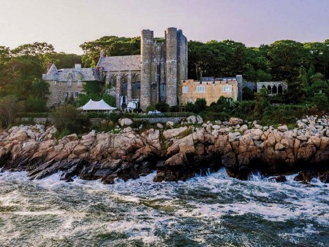 Majestic twentieth-century stone castle perched on Gloucester coastline
