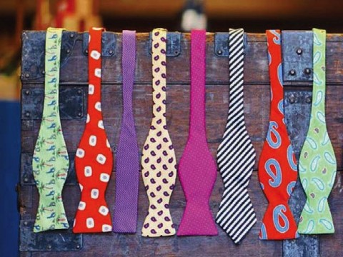 A display rack holding colorful men's bow ties